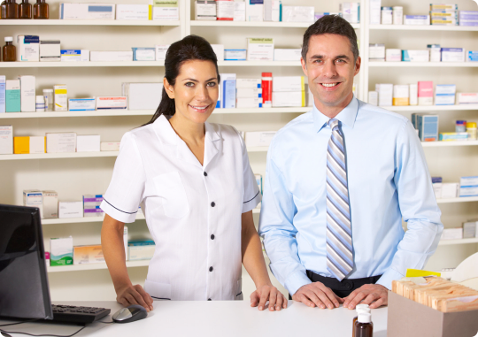 male and female pharmacist smiling