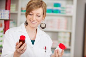 pharmacist holding bottles of medicines